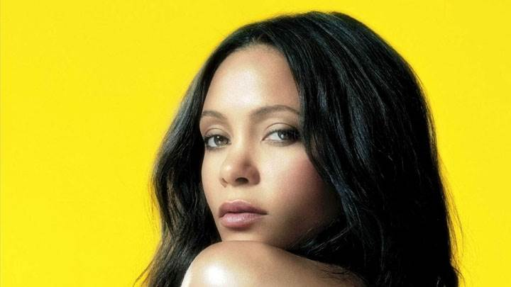 Thandie Newton Side Face Closeup And Yellow Background