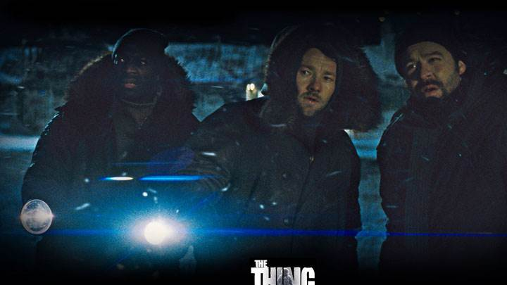 The Thing – Adewale Akinnuoye Agbaje And Joel Edgerton Torch In Hand