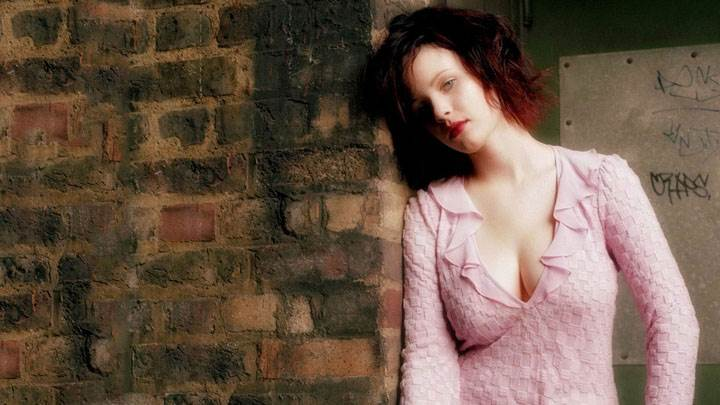 Thora Birch Standing With Wall In Pink Dress