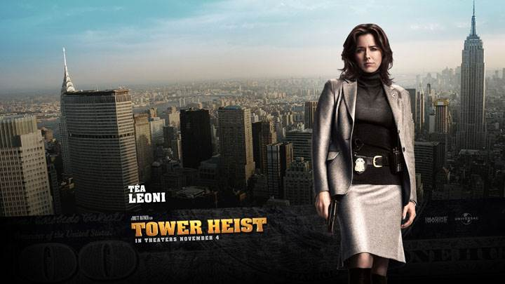 Tower Heist – Tea Leoni In Grey Coat And Gun In Hand