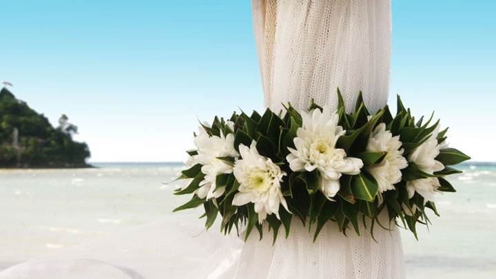 Wedding Flowers On Curtains Near Beach