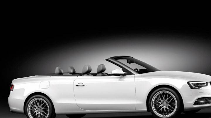 White Audi A5 Cabriolet Side Pose And Black Backgrond