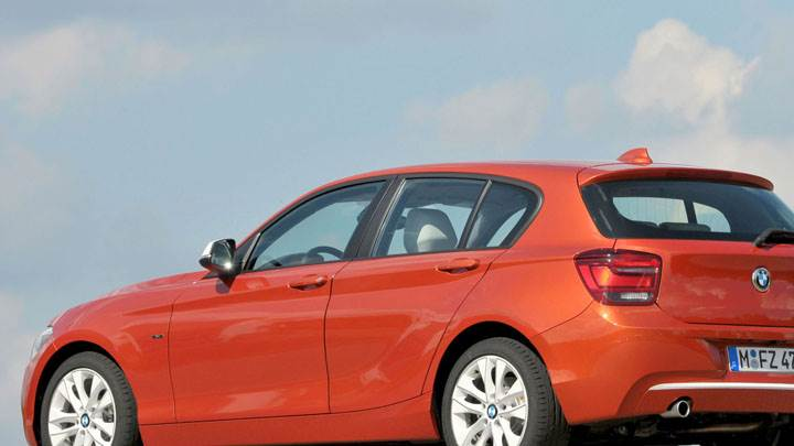 2012 BMW 1-Series 120d Side Pose in Orange