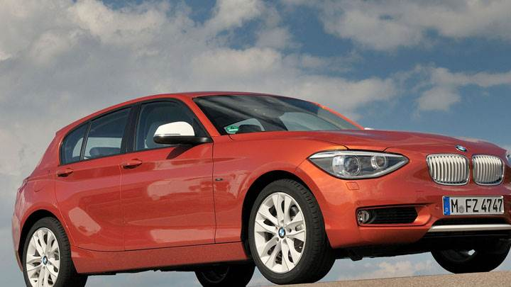 2012 BMW 1-Series Front Side Pose in Orange