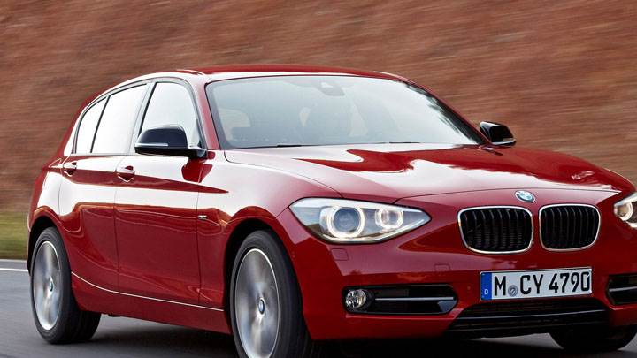 2012 BMW 1-Series On Highway Front Pose in Red