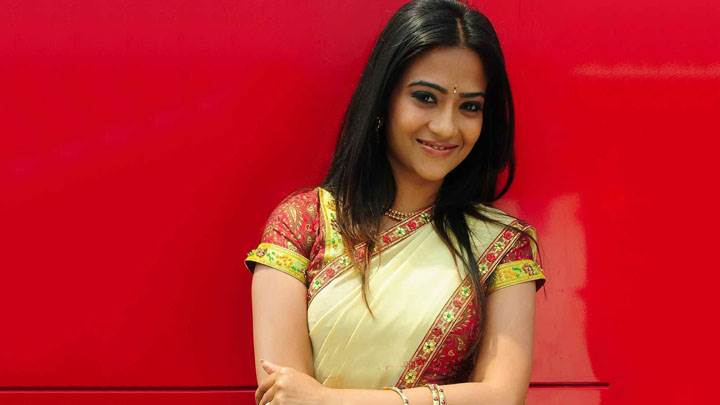 Aditi Sharma Smiling Front Pose In Saree And Red Background