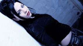 Amy Lee Side Pose In Black Top And Jeans