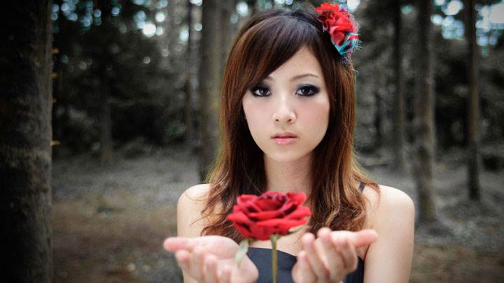Asian Girl Magic With Red Rose in Forest