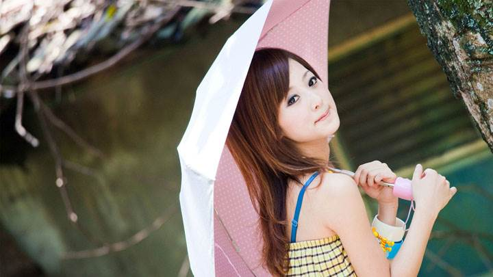 Asian Girl With Pink Umbrella Side Pose