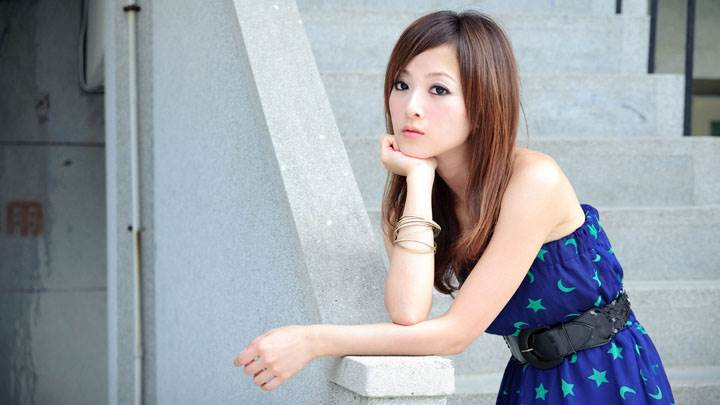 Asian Model Innocent Face Pose In Blue Dress Near Stairs