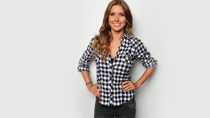 Audrina Patridge Smiling Modeling Pose In Black And White Shirt And Black Jeans