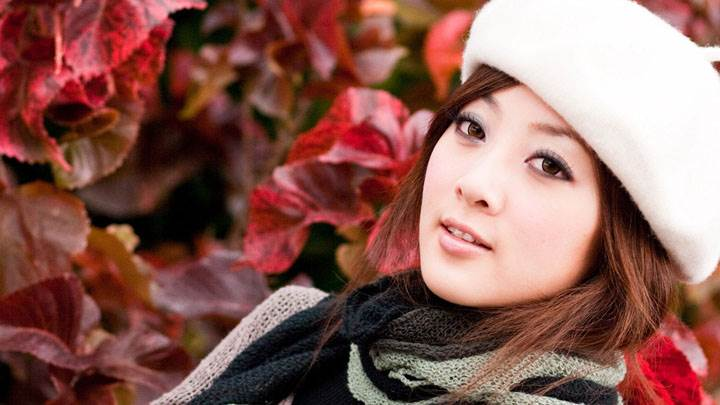 Beautiful Asian Girl Face Closeup in White Cap