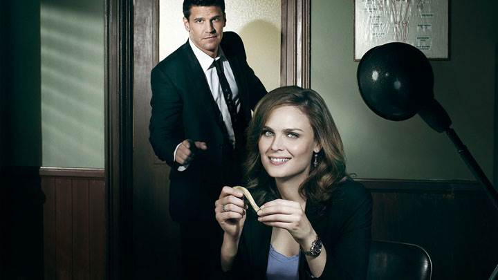 Bones – Emily Deschanel Smiling Sitting Pose in Office