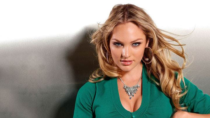 Candice Swanepoel Sitting In Green Top And Looking Front