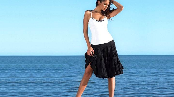 Carla Ossa In White Top And Black Skirt Modeling Pose At Sea Side