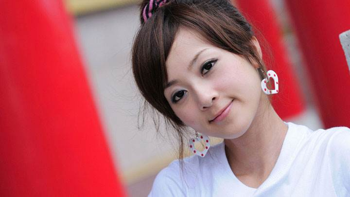 Cute Smiling Face Of Asian Girl in White Top And White Earings