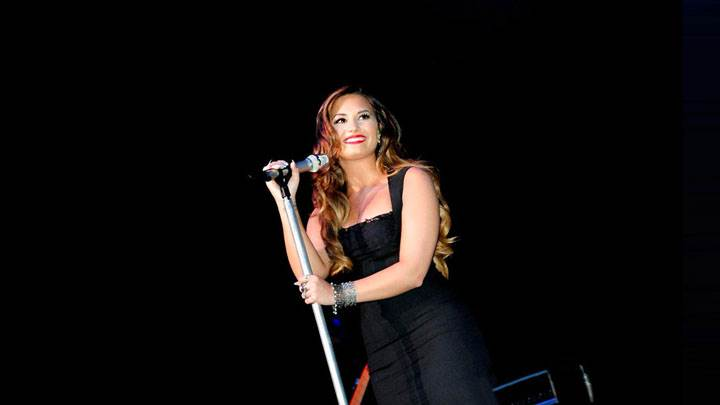 Demi Lovato Smiling And Adjusting The Mic At The Wiltern In Hollywood
