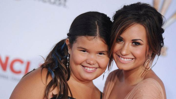 Demi Lovato Smiling With Girl In Event