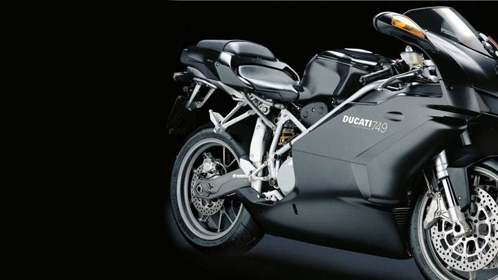 Ducati 749 2005 in Black Side Pose And Black Background