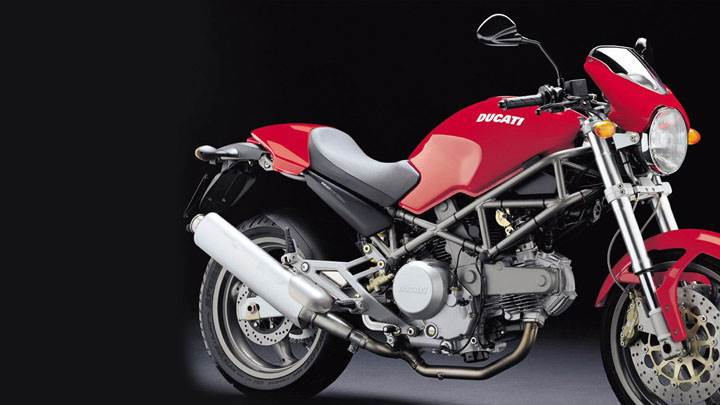 Ducati Monster 620 2004 in Red Side Pose And Black Background