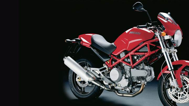 Ducati Monster 620 2005 in Red Side Pose And Black Background