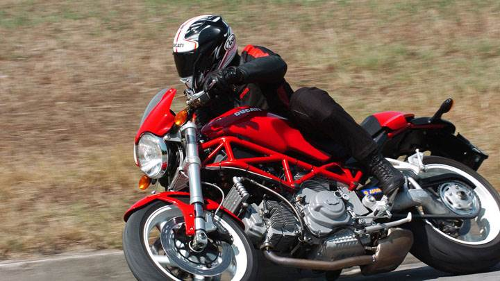 Ducati Monster S2r-1000 2005 in Red Ridind on Race Track