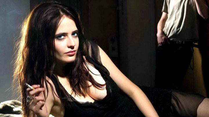 Eva Green Laying Pose In Black Dress And Cigarette In Hand