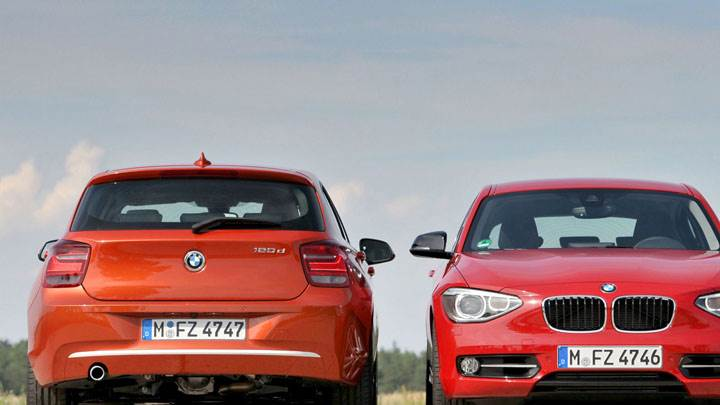 Front And Back Pose of 2012 BMW 1-Series in Orange And Red