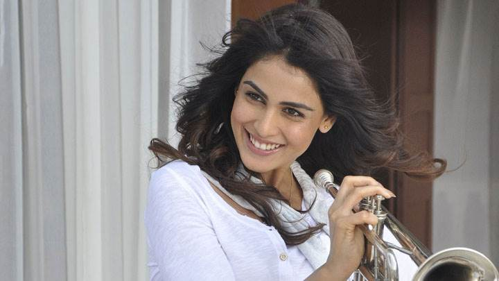 Genelia D'souza Smiling And Music Band In Hand