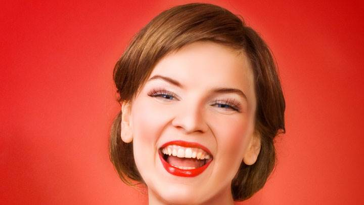 Girl Laughing Madly Face Closeup & Red Background