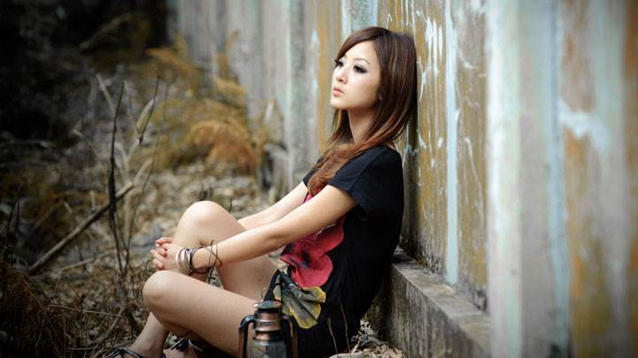 Girl Lost In Love – Sitting Pose in Black Top