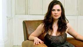 Hayley Atwell Sitting On Sofa In Black Dress