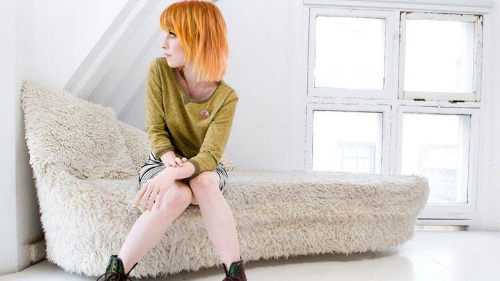 Hayley Williams Sitting On Sofa Looking Side