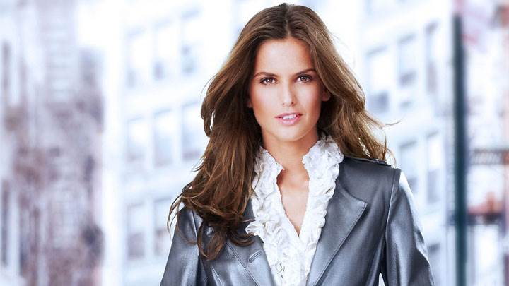 Izabel Goulart Smiling In Black Coat Looking Front