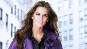 Izabel Goulart Smiling In Black Shirt And Purpe Coat