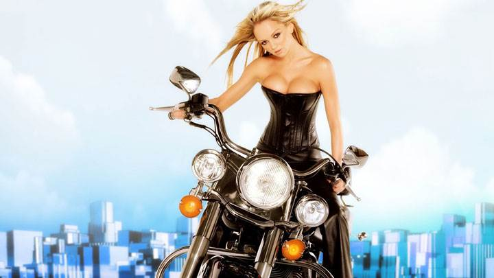 Jennifer Ellison On Bike In Black Long Dress