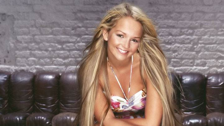 Jennifer Ellison Smiling Sitting Pose And Long Hairs