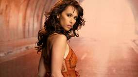 Jennifer Love Hewitt Side Pose In Orange Dress