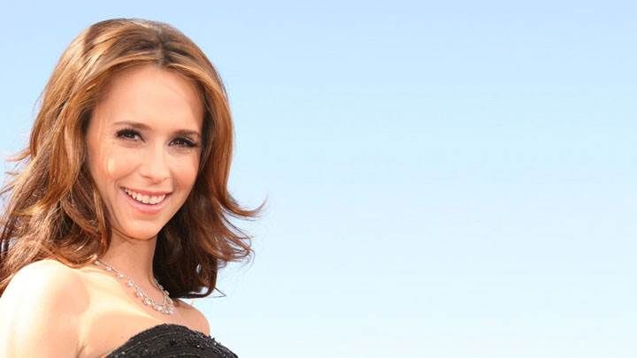Jennifer Love Hewitt Smiling In Black Dress And Blue Background