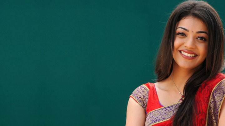 Kajal Aggarwal Cute Smiling Face In Red Saree And Long Hairs
