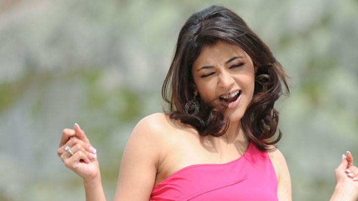 Kajal Aggarwal Lazy Photoshoot In Pink Dress