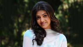 Kajal Aggarwal Smiling Cute Eyes Looking Front
