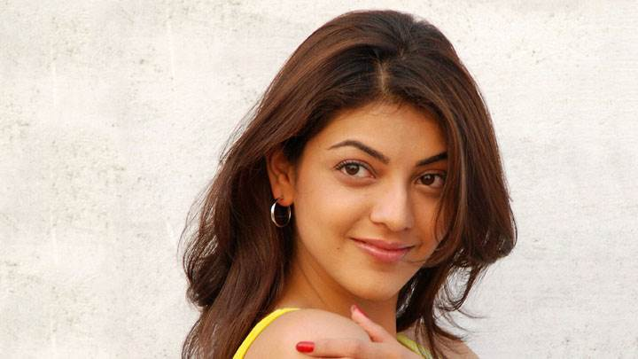 Kajal Aggarwal Smiling Cute Face And Showing Red Nails