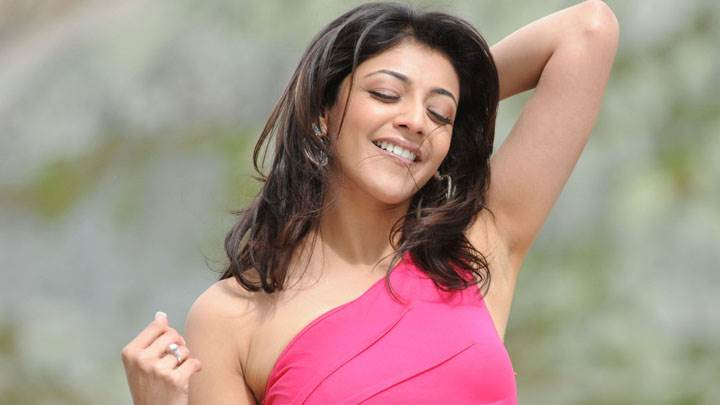 Kajal Aggarwal Smiling In Pink Dress Naughty Pose