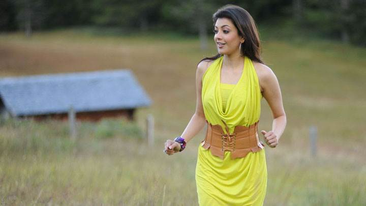 Kajal Aggarwal Smiling In Yellow Dress In Field