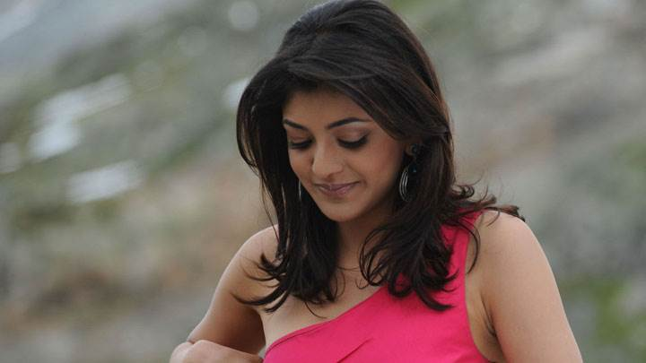 Kajal Aggarwal Smiling Looking Down In Pink Dress