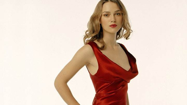 Keira Knightley In Red Dress And Red Lips In Modeling Pose And White Background