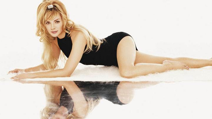 Kim Cattrall Laying In Black Dress And Reflection On Floor