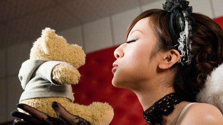 Kissing The Teddy in Hand And Closed Eyes