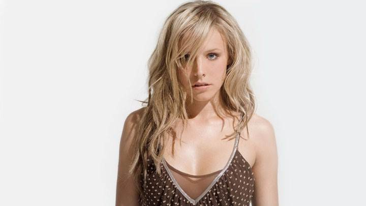 Kristen Bell In Brown Top Looking Front And White Background